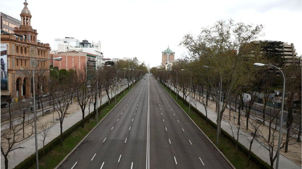 An almost deserted Paseo de la Castellana street in Madrid, Spain