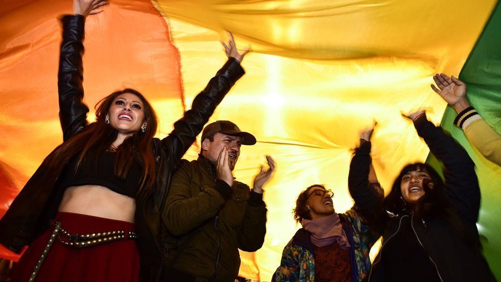 People celebrates after the Ecuador's Constitutional Court approved equal civil marriage, in Quito