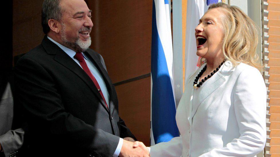 Avigdor Lieberman shakes hands with Hillary Clinton in Jerusalem (16 July 2012)