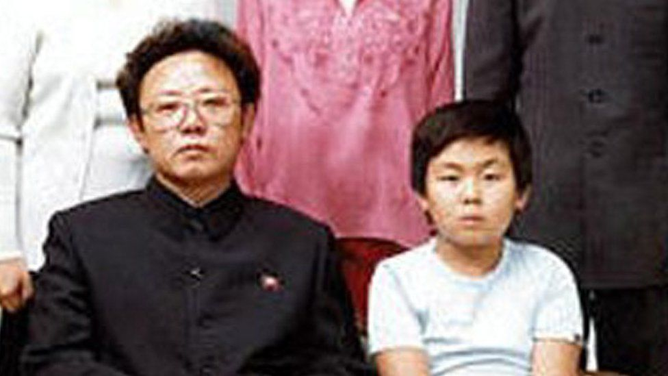 North Korean leader Kim Jong Il, bottom left, poses with his first-born son Kim Jong Nam, bottom right,