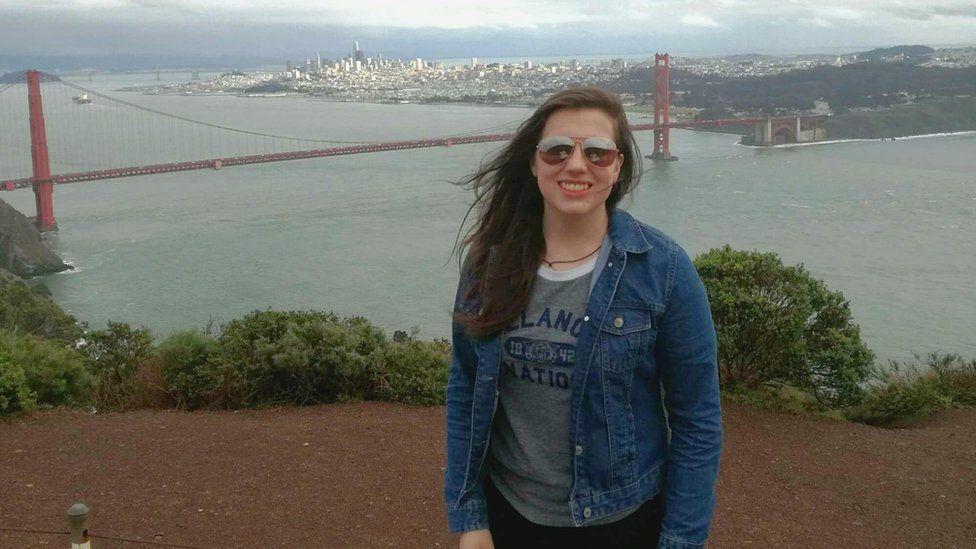 Sarah posing in front of San Francisco's Golden Gate bridge