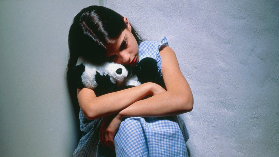Young girl with a sad expression