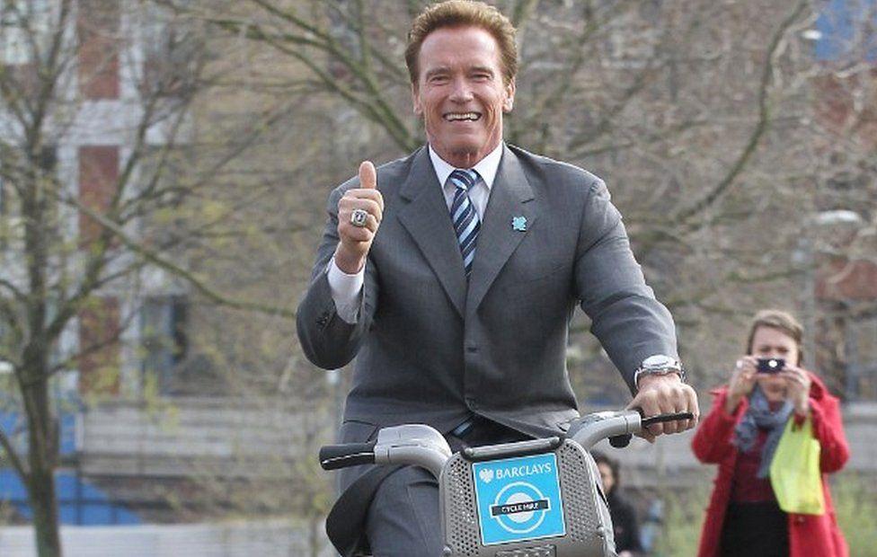Arnold Schwarzenegger on bike