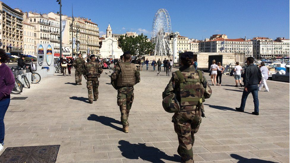 Soldiers patrolling along the waterside in Marseille