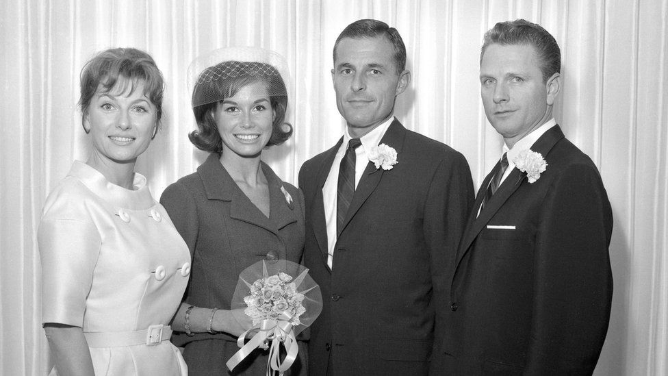 Mary Tyler Moore and Grant Tinker on their wedding day with two guests