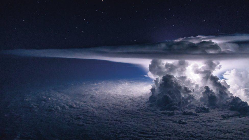 White clouds over a dark blue sky