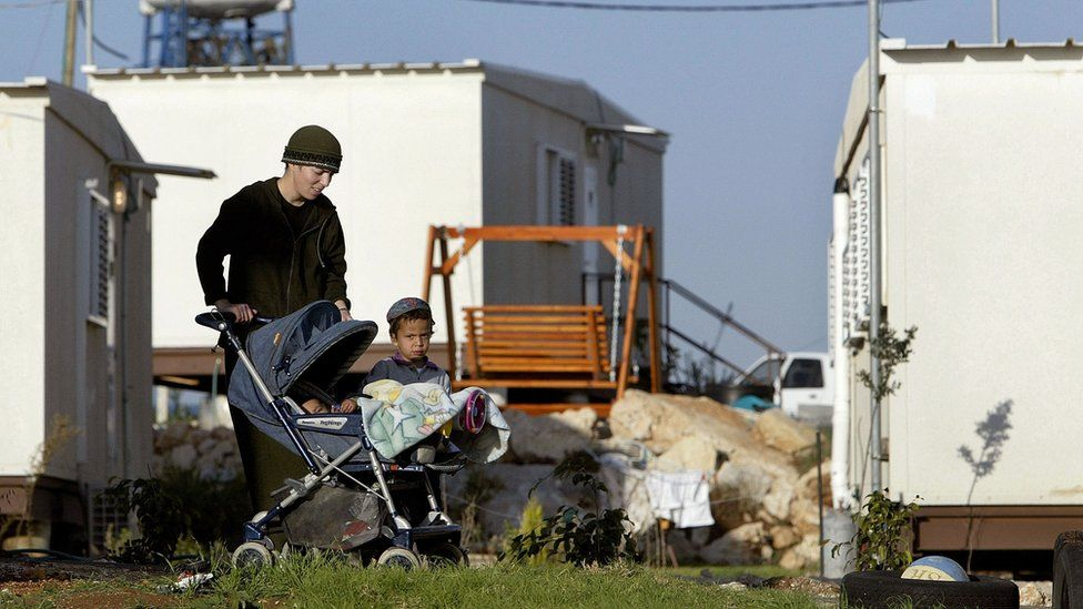 Woman and children at outpost of Migron (file photo)