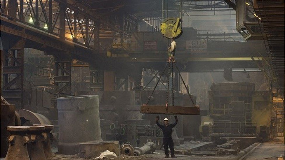 Worker casts steel ingot