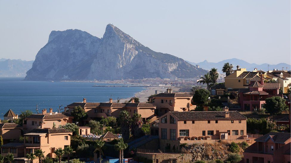 Modern apartments cover the hillside in front of the Rock of Gibraltar