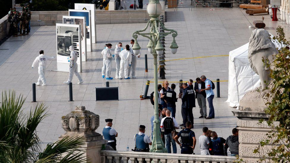 Police investigators work outside the Saint Charles train station after French soldiers shot and killed a man who stabbed two women to death at the main train station in Marseille, France (October 1, 2017)