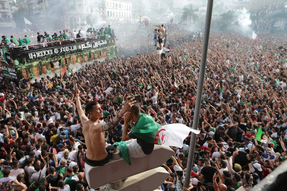 Tens of thousands Algerian fans welcome the players of Algeria national football team at Houari Boumediene Airport, in Algiers, Algeria - 20 July 2019