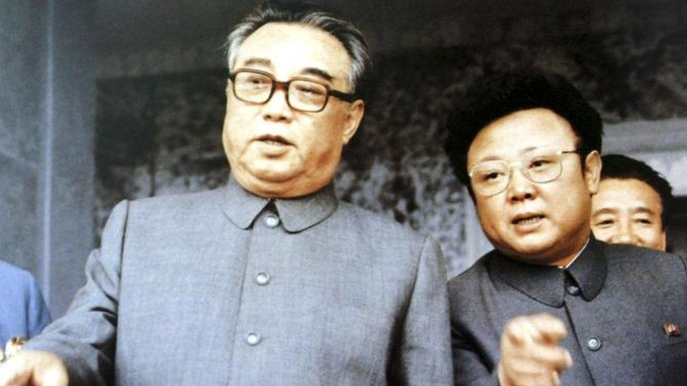 Kim Il-sung, left, founder of North Korea, chats with his son Kim Jong-il at a mass rally to celebrate the foundation of the communist country in Pyongyang in this September 1983
