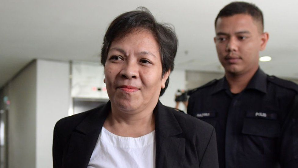 Maria Elvira Pinto Exposto (L), 54, is escorted upon her arrival at the Shah Alam High Court ahead of the verdict in her drugs conviction in Shah Alam, outside Kuala Lumpur, on December 27,