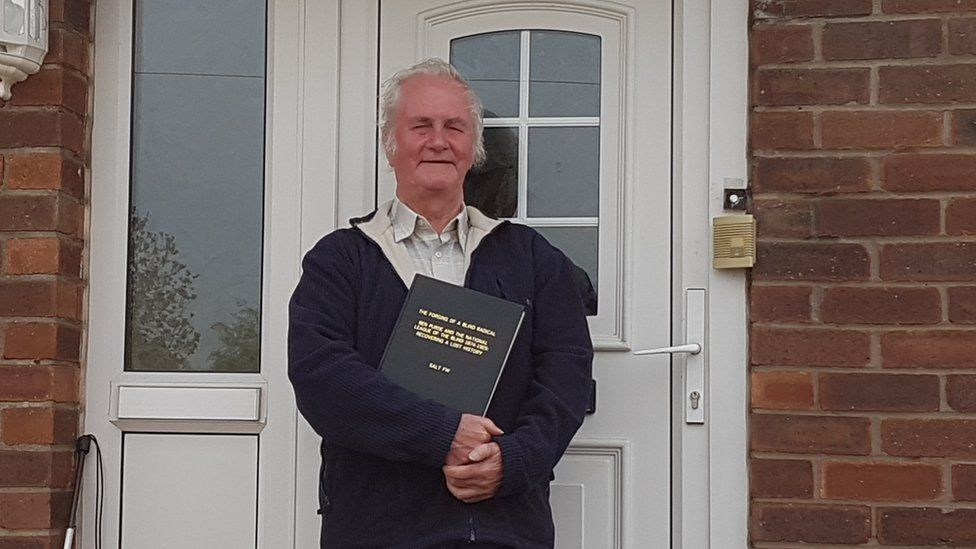 Historian Francis Salt standing outside his house