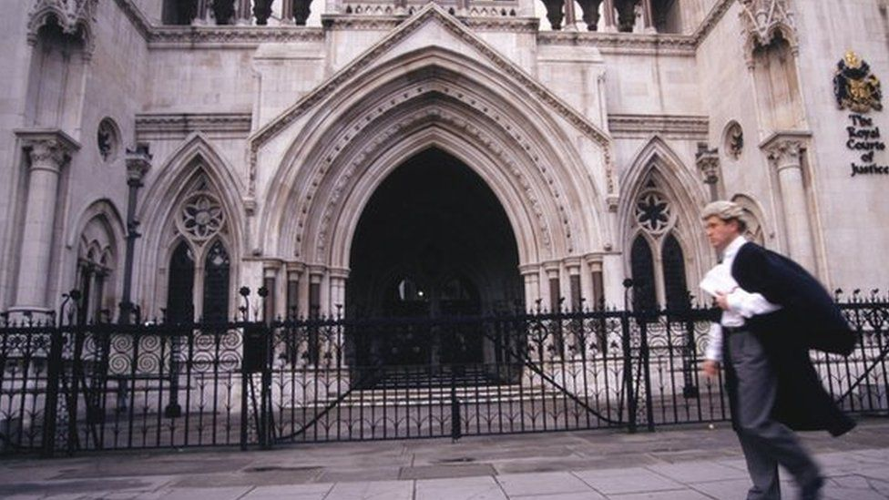 Barrister walking past a court