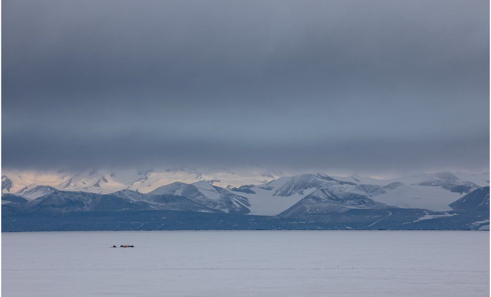 Antarctic landscape with mountains and tents