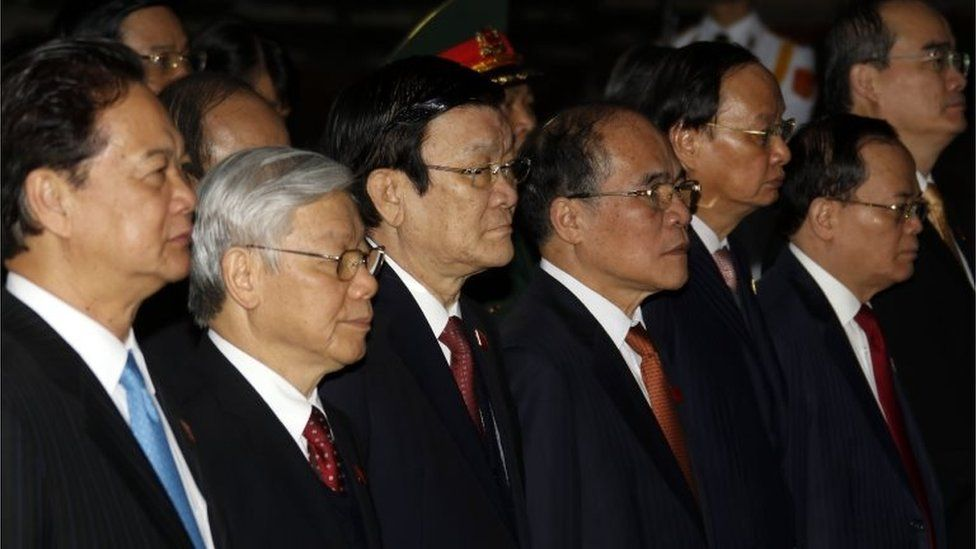 """(L-R) Prime Minister Nguyen Tan Dung, Vietnam Communist Party""""s Secretary General Nguyen Phu Trong, President Truong Tan Sang, National Assembly Chairman Nguyen Sinh Hung, Head of the PCC Commission for Organization To Huy Rua, Head of the Party Central Committee""""s Inspection Commission Ngo Van Du, Chairman of the Vietnam Fatherland Front Central Committee Nguyen Thien Nhan attend a wreath laying ceremony at the mausoleum of Vietnamese late president Ho Chi Minh prior to the 12th National Congress of Vietnam""""s Communist Party (VCP), in Hanoi on January 20, 2016."""