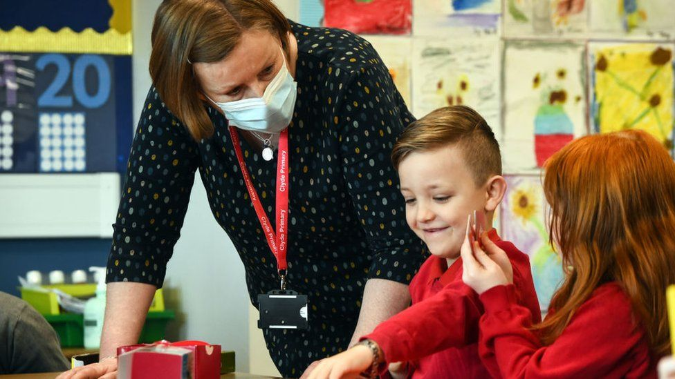Pupils take part in a class at Clyde Primary School in Glasgow on February 22, 2021