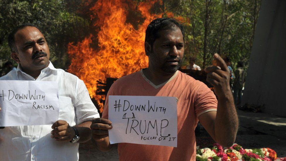 Supporters of the killed Indian engineer Srinivas Kuchibhotla, who was shot dead in the US state of Kansas, take part in a protest against racism and US President Donald Trump, in front of Kuchibhotla's burning funeral pyre, in Hyderabad on February 28, 2017.