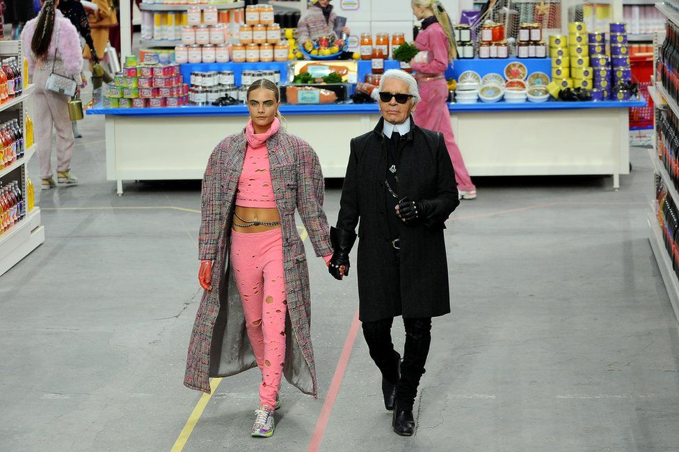 Fashion Designer Karl Lagerfeld and model Cara Delevingne appear at the end of the runway during the Chanel show as part of the Paris Fashion Week Womenswear Fall/Winter 2014-2015 on March 4, 2014 in Paris, France.