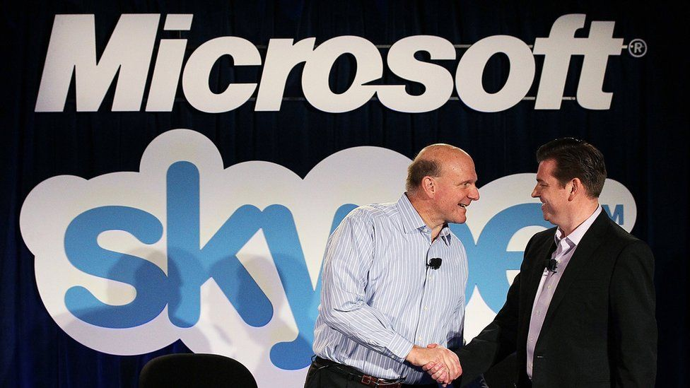 Steve Balmer shakes hands with then-Skype chief executive Tony Bates at a 2011 conference announcing Microsoft's acquisition