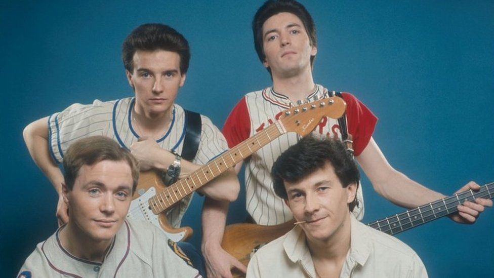 Midge Ure - pictured top left, with guitar - with bandmates from Slik