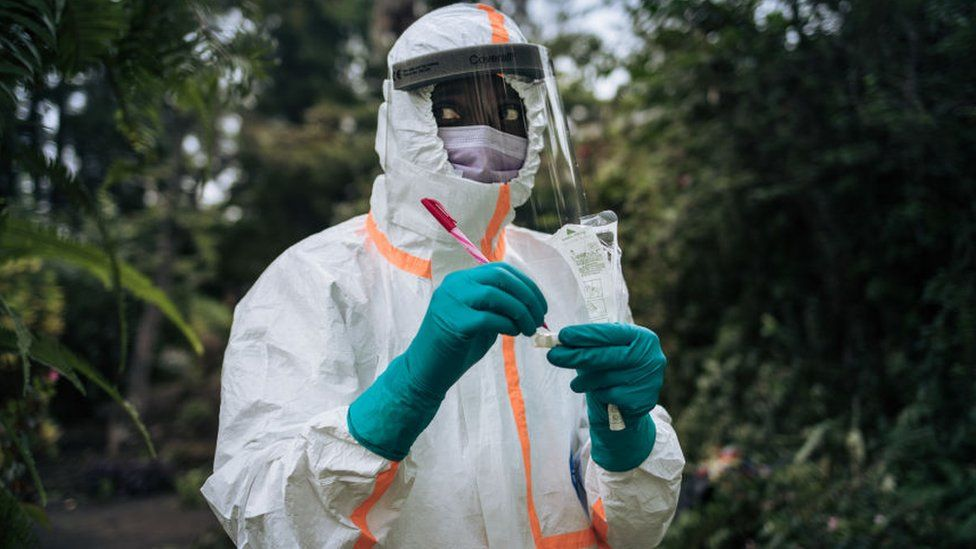 A staff member of the Congolese Ministry of Health prepares the sampling equipment to perform a COVID-19 test at a private residence in Goma, northeastern Democratic Republic of Congo, on March 31, 2020
