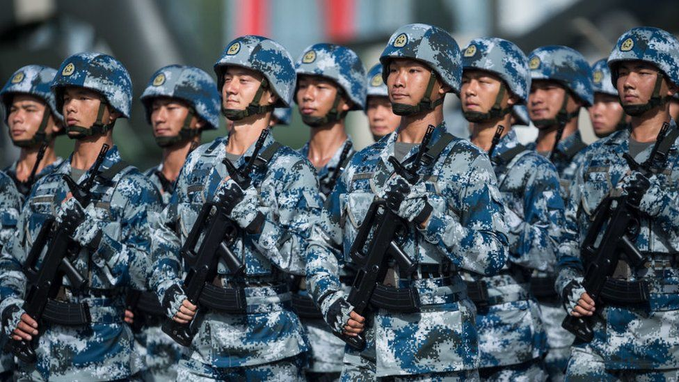 People's Liberation Army soldiers prepare for the arrival of China's President Xi Jinping at the Shek Kong barracks in Hong Kong on 30 June 2017