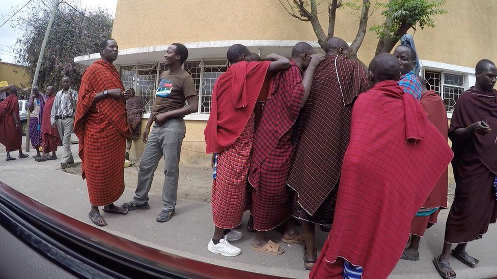 Tanzanite street sellers dressed in Maasai clothing