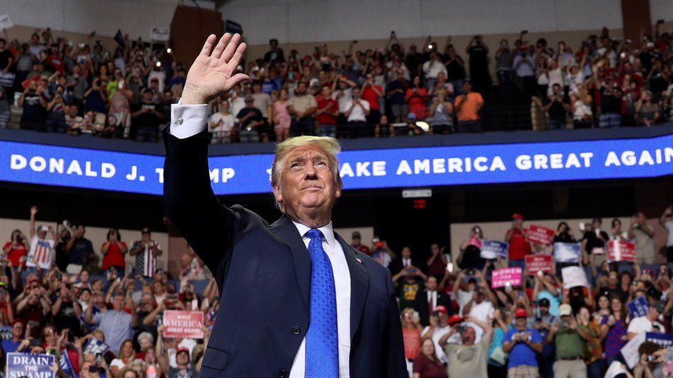 President Donald Trump rallies supporters during a Make America Great Again rally in Southaven, Mississippi, 2 October 2018