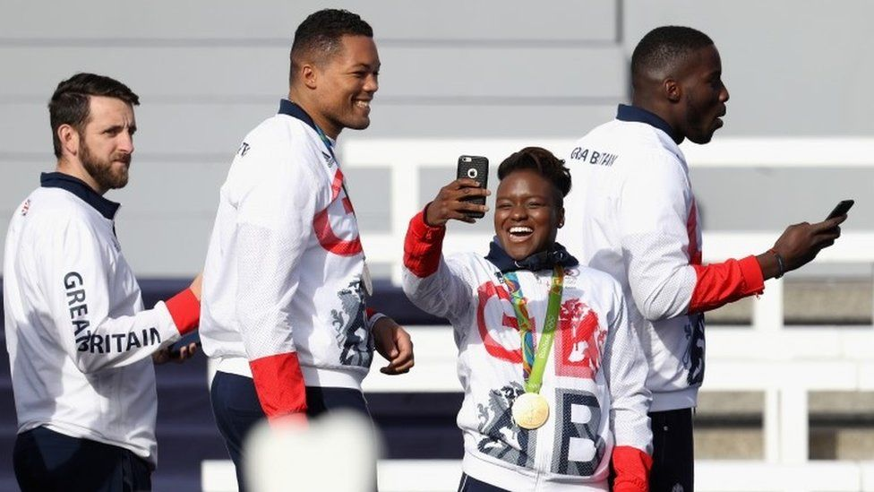 Nicola Adams takes a photo on her phone
