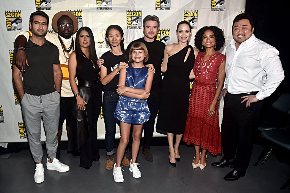 Chloe Zhao (fourth from left) with the cast of Eternals