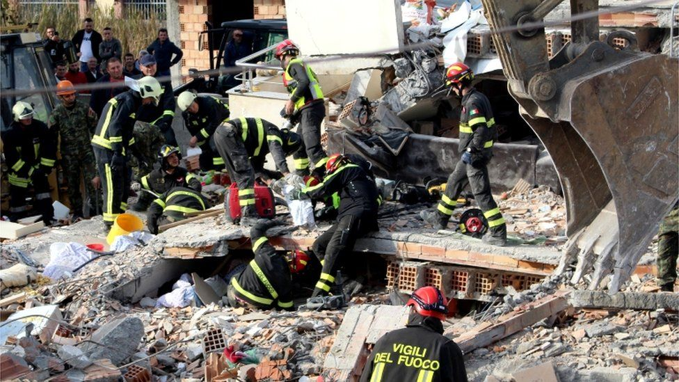 Rescue teams from Italy search for bodies in the rubble of a building in Durres, Albania, 27 November 2019