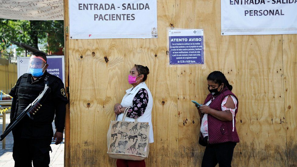 Relatives of patients wait outside a hospital in Mexico City
