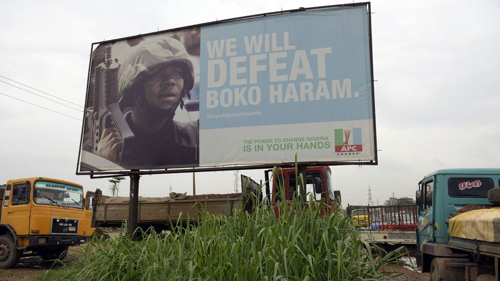 Campaign signboad displayed by the ruling All Progressives Congress (APC) to show its readiness to defeat Boko Haram Islamists on assumption office at Ogijo, Ogun State in southwest Nigeria, on July 3, 2015
