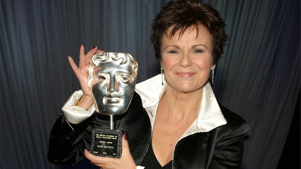 Dame Julie Walters holds a special Bafta award