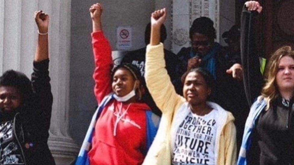 Women with fist in air