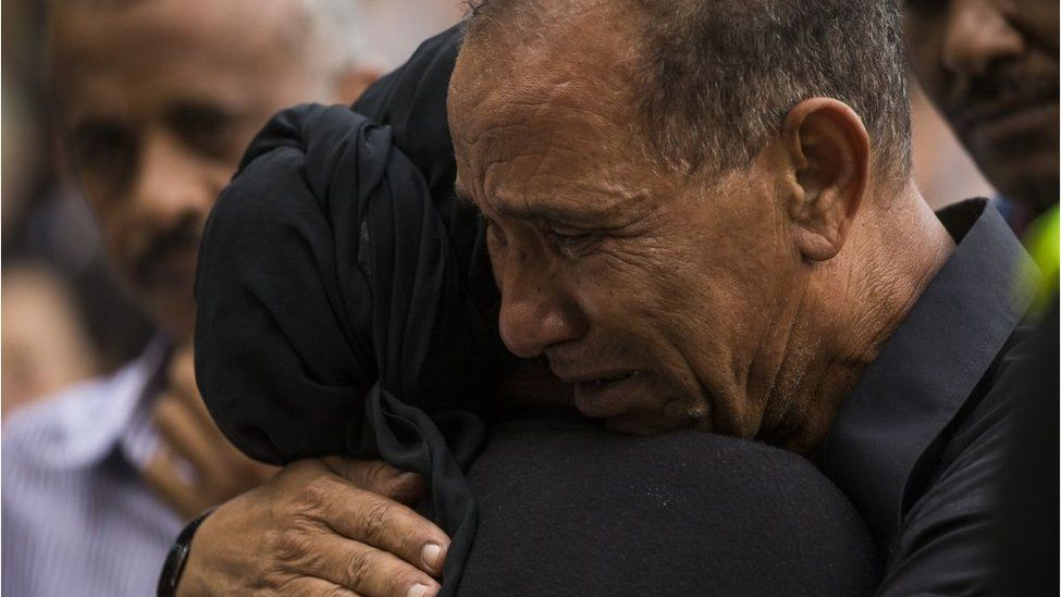 Mahmoud Hassanen embraces a family member during the vigil at Lake Anne Plaza for his daughter Nabra Hassanen