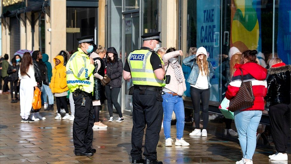 Shoppers queue in Edinburgh