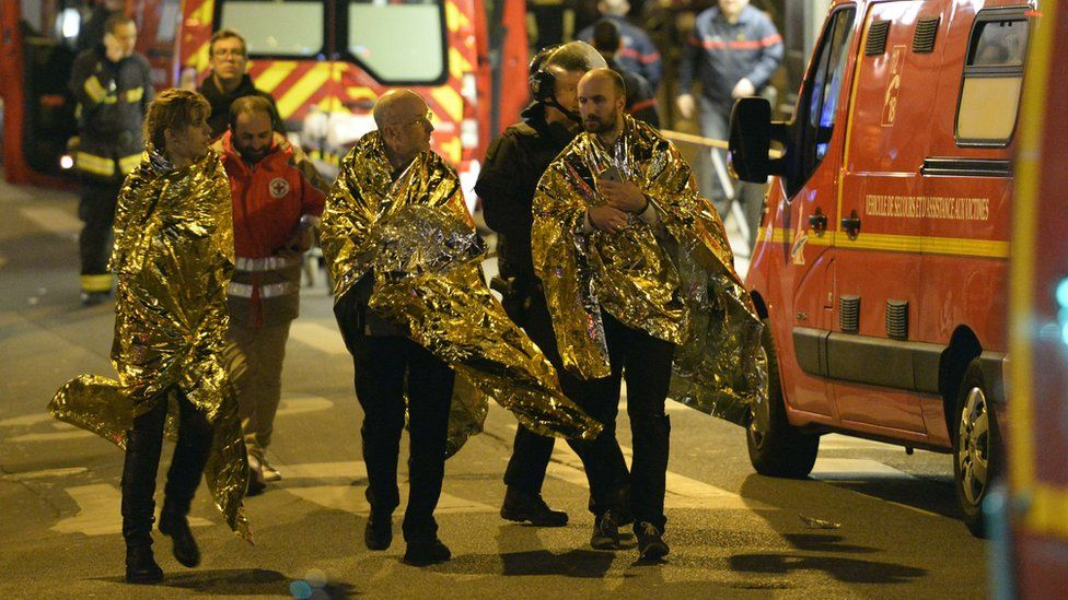 People being evacuated near the Bataclan concert hall
