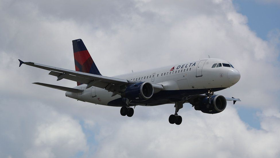 Delta Airlines plane in the air
