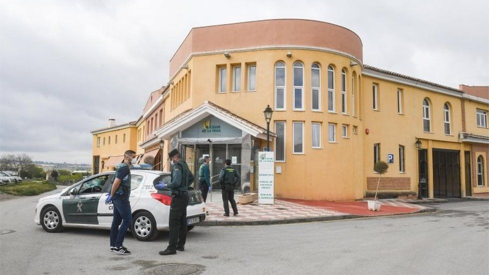 Civil Guard officers outside a nursing home for elderly people in Cajar, southern Spain, 26 March 2020.