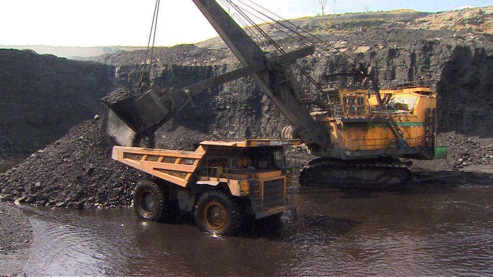 A crane working an open cast mine in India
