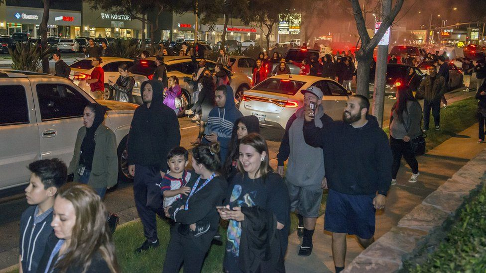 Protesters march towards the off-duty officer's home in Anaheim, California