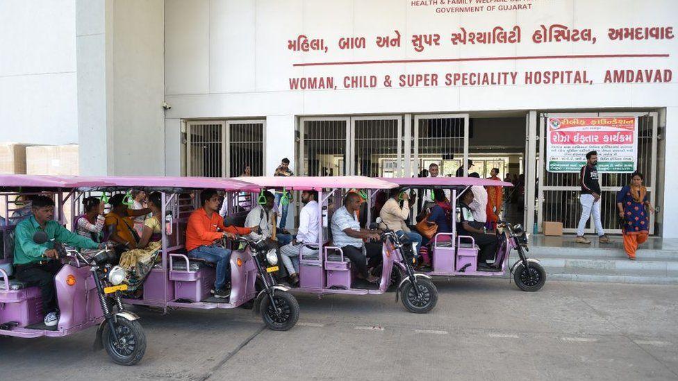 e-rickshaws parked outside a Gujarat hospital