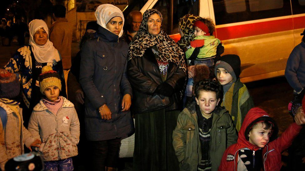 People wait to leave the besieged town of Madaya, Syria (11 January 2016)