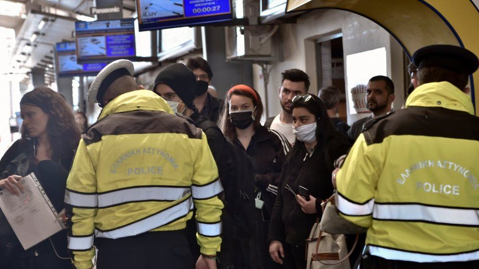 A policeman, wearing a face mask for protect from coronavirus, check documents verifying purpose of movement during the coronavirus disease (COVID-19) outbreak on 17 April