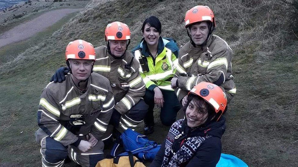 Yasmin Khan (centre) with her rescuers from West Midlands Ambulance Service and Hereford and Worcester Fire and Rescue Service