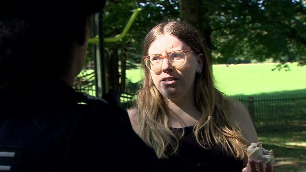 A mother at a park in Bristol speaking to police about coronavirus rules