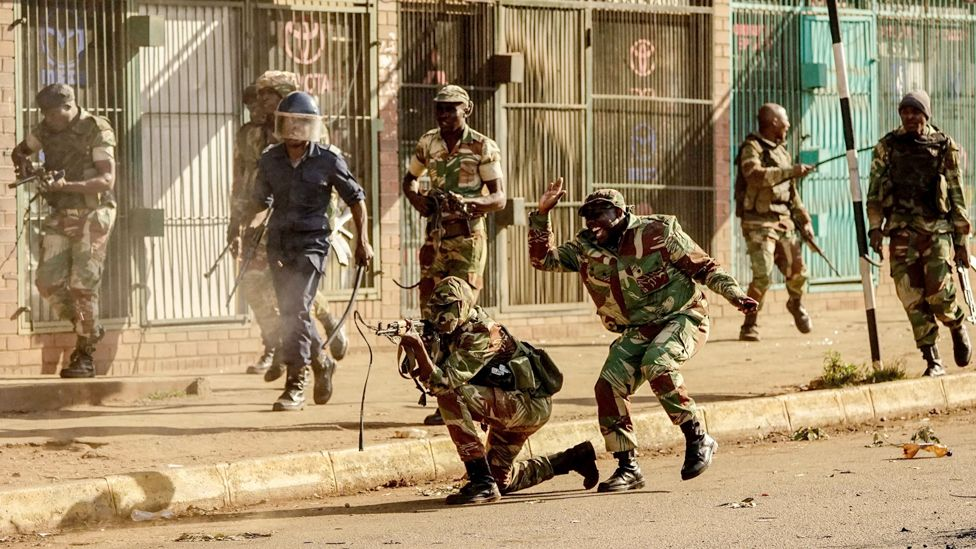 A soldier fires shots towards demonstrators as protests erupted over alleged fraud in the country's election, Harare, Zimbabwe - 1 August 2018